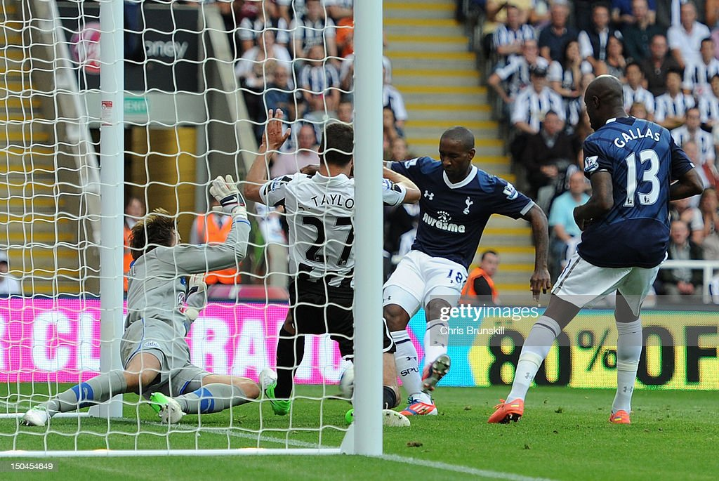 Jermain Defoe of Tottenham Hotspur scores his team's first goal during the Barclays Premier League match between Newcastle United and Tottenham Hotspur at Sports Direct Arena on August 18, 2012 in Newcastle upon Tyne, England.