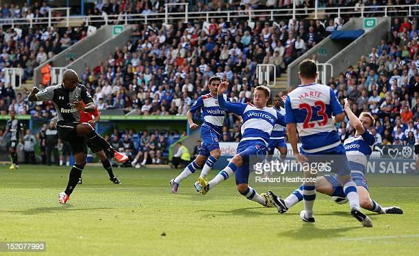 Jermain Defoe of Tottenham Hotspur scores the opening goal during the Barclays Premier League match between Reading and Tottenham Hotspur at Madejski...