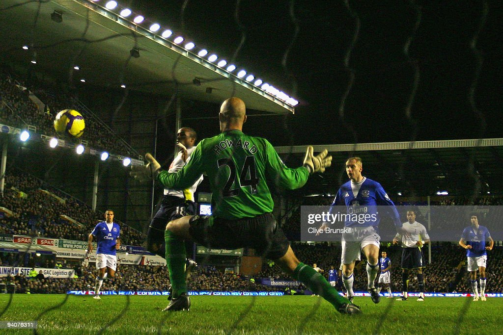 Jermain Defoe of Tottenham Hotspur scores the opening goal past Tim Howard of Everton during the Barclays Premier League match between Everton and Tottenham Hotspur at Goodison Park on December 6, 2009 in Liverpool, England.