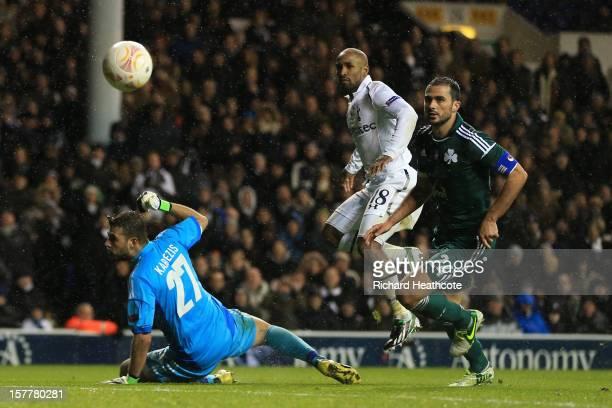 Jermain Defoe of Tottenham Hotspur scores their third goal past Orestis Karnezis of Panathinaikos during the UEFA Europa League Group J match between...