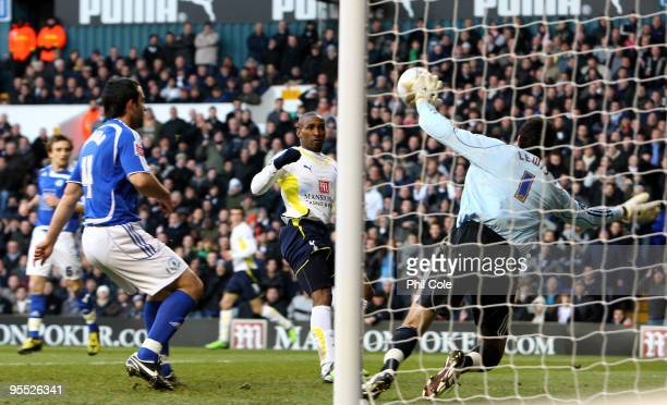 Jermain Defoe of Tottenham Hotspur shoots and hits the cross bar during the FA cup 3rd Round match between Tottenham Hotspur and Peterborough United...