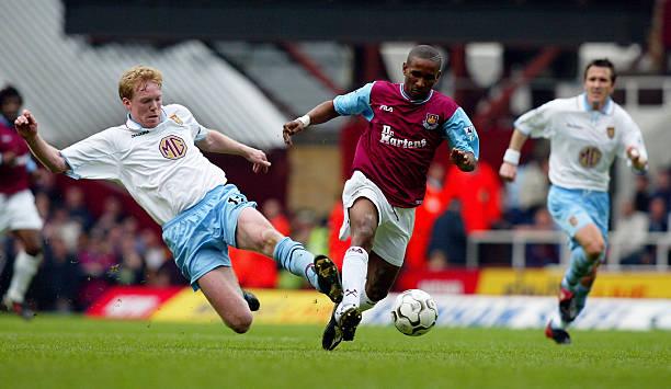 Jermain Defoe of West Ham United and Steve Staunton of Aston Villa