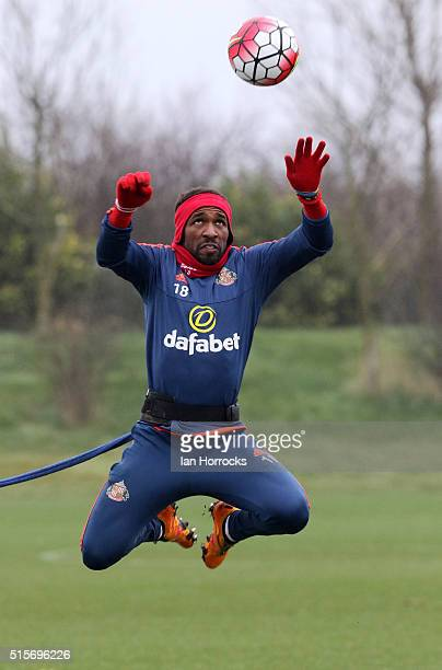 Jermain Defoe trains at the end of a bungee chord during a Sunderland training session at the Academy of Light on March 15, 2016 in Sunderland,...