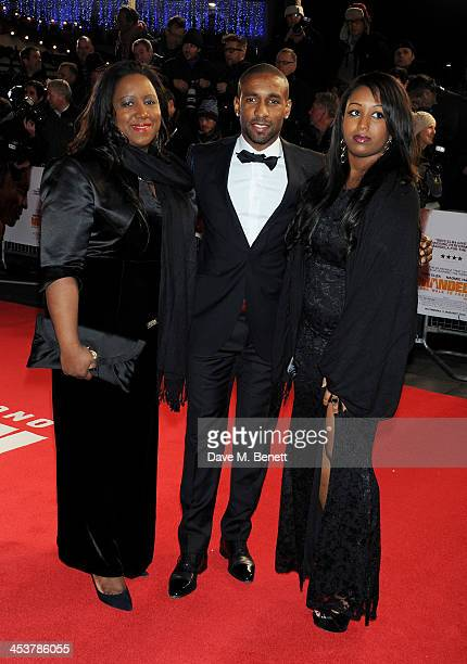 """Jermain Defoe with mother and sister Jade Defoe attend the Royal Film Performance of """"Mandela: Long Walk to Freedom"""" at Odeon Leicester Square on..."""