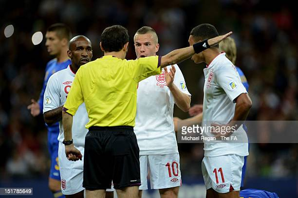 Jermain Defoe,Tom Cleverley and Alex Oxlade-Chamberlain of England remonstate with Referee Cuneyt Cakir of Turkey after Defoe's early goal was...