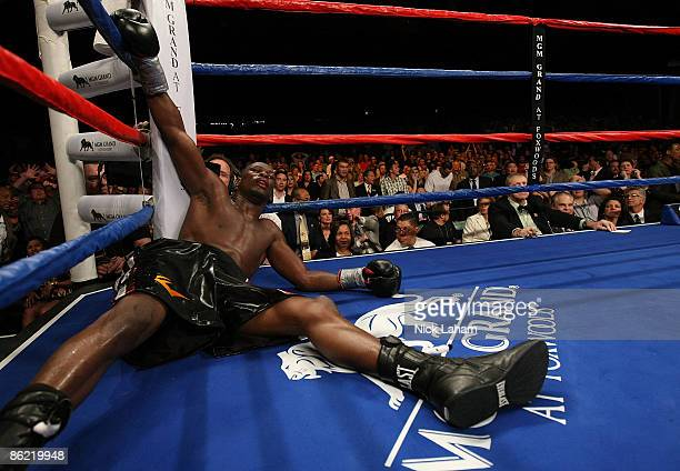 Jermain Taylor lays on the canvas after being knocked down in the 12th round by Carl Froch during their WBC Super Middleweight Championship bout at...
