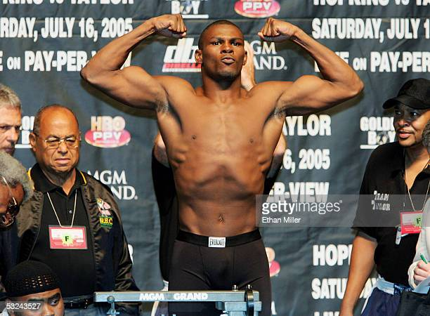 Jermain Taylor of Arkansas poses on the scale during the official weighin for his title fight against undisputed middleweight champion Bernard...