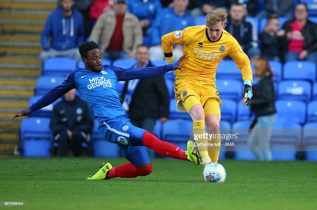 Jermaine Anderson of Peterborough United tackles Dean Henderson of Shrewsbury Town during the Sky Bet League One match between Peterborough United and Shrewsbury Town at ABAX Stadium on October 28, 2017 in Peterborough, England.