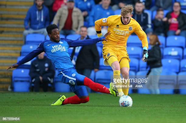 Jermaine Anderson of Peterborough United tackles Dean Henderson of Shrewsbury Town during the Sky Bet League One match between Peterborough United...