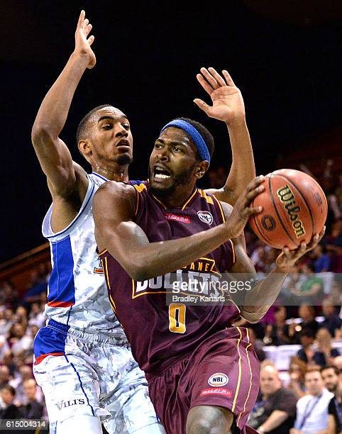 Jermaine Beal of the Bullets takes on the defence of Terrance Ferguson of Adelaide during the round two NBL match between the Brisbane Bullets and...