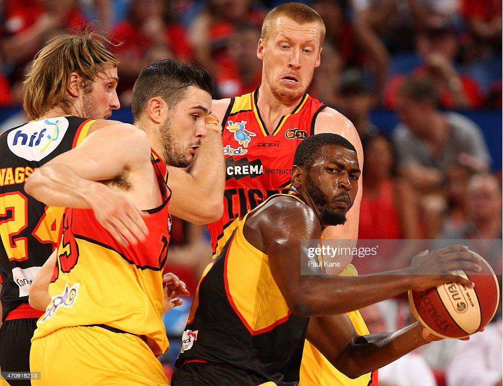 Jermaine Beal of the Wildcats controls the ball against Chris Goulding and Adam Ballinger of the Tigers during the round 19 NBL match between the Perth Wildcats and the Melbourne Tigers at Perth Arena on February 21, 2014 in Perth, Australia.