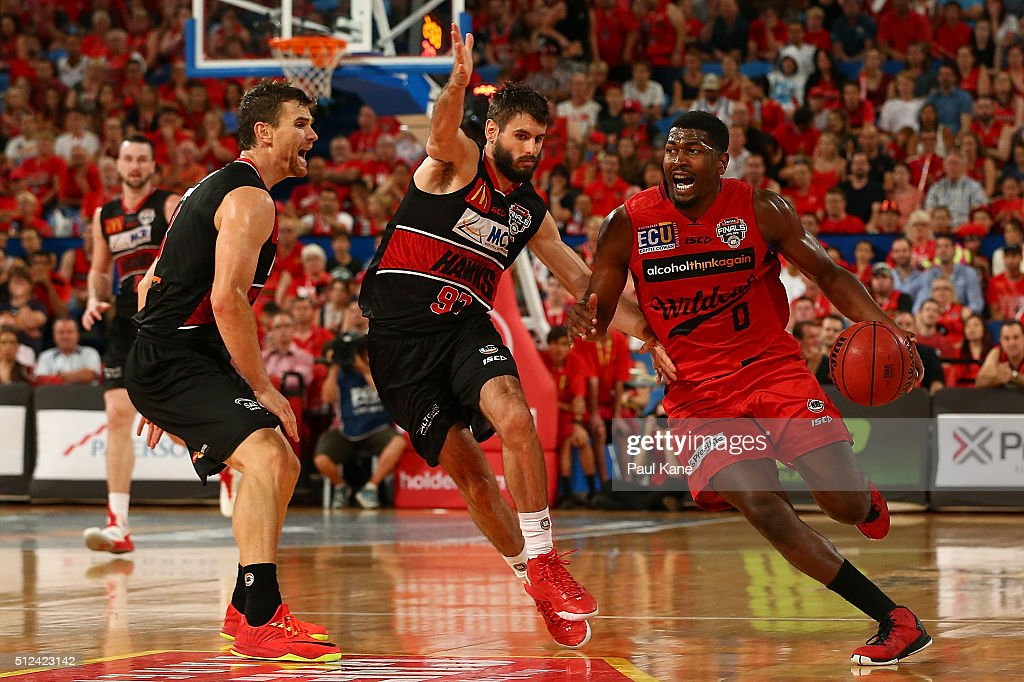 Jermaine Beal of the Wildcats drives to the basket against Jarrad Weeks of the Hawks during the NBL Semi Final match between Perth Wildcats and Illawarra Hawks at Perth Arena on February 26, 2016 in Perth, Australia.
