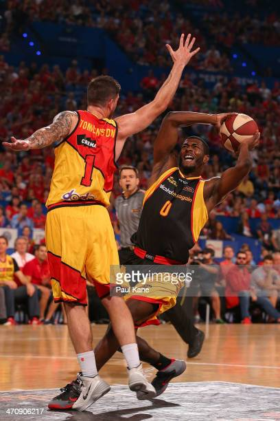 Jermaine Beal of the Wildcats drives to the basket against Nate Tomlinson of the Tigers during the round 19 NBL match between the Perth Wildcats and...