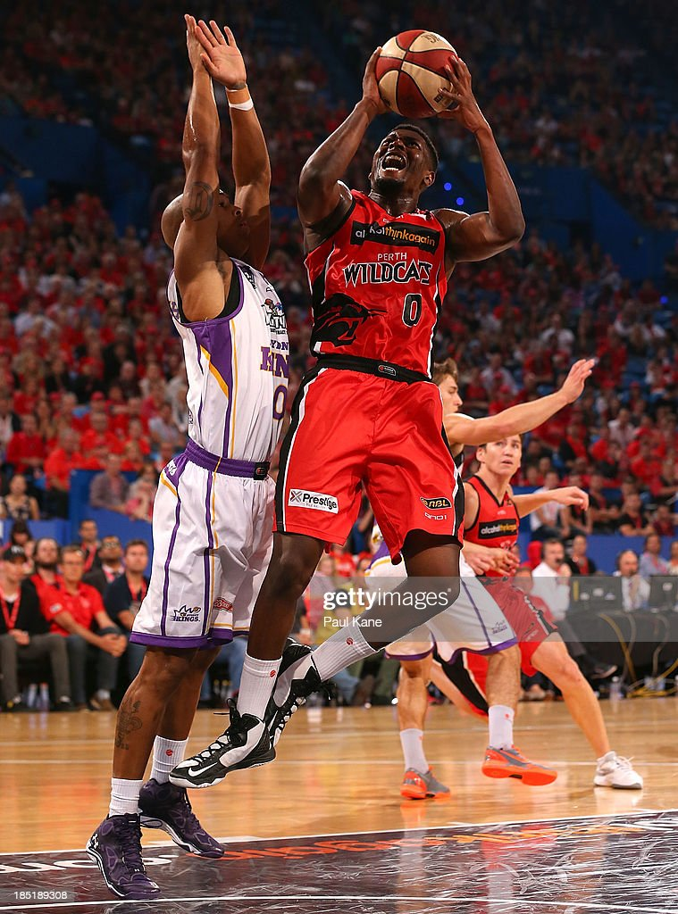 Jermaine Beal of the Wildcats lays up against Charles Carmouche of the Kings during the round two NBL match between the Perth Wildcats and the Sydney Kings at Perth Arena in October 18, 2013 in Perth, Australia.