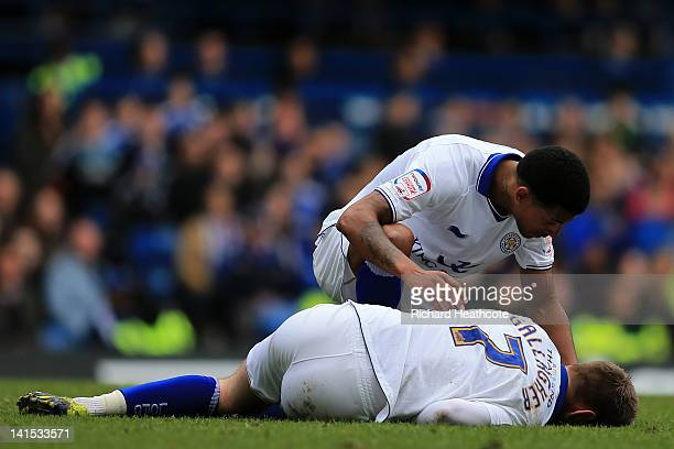 Jermaine Beckford checks on injured team mate Paul Gallagher of Leicester City during the FA Cup sixth round match between Chelsea and Leicester City...