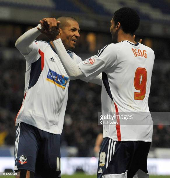 Jermaine Beckford of Bolton Wanderers celebrates with teammate David Ngog after he scores the second goal of the game for his side during the...
