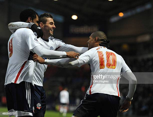 Jermaine Beckford of Bolton Wanderers celebrates with teammate David Ngog and Andre Moritz after he scores the second goal of the game for his side...