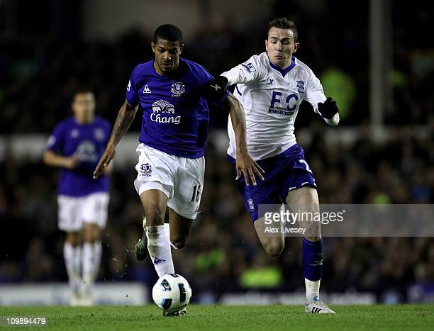 Jermaine Beckford of Everton battles for the ball with Jordan Mutch of Birmingham City during the Barclays Premier League match between Everton and...