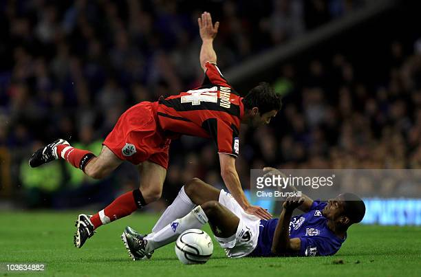 Jermaine Beckford of Everton collides for the ball with Damien Johnson of Huddersfield Town during the Carling Cup second round match between Everton...