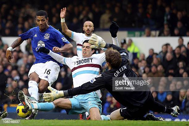 Jermaine Beckford of Everton has a shot saved by Robert Green West Ham in action during the Barclays Premier League match at Goodison Park on January...