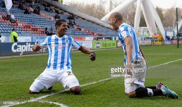 Jermaine Beckford of Huddersfield celebrates with James Vaughan after scoring his second goal during the npower Championship match between...