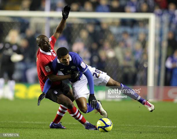 Jermaine Beckford of Leicester is challenged by George Boateng of Forest during the FA Cup 3rd round replay between Leicester City and Nottingham...