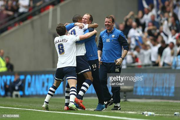 Jermaine Beckford of Preston North End celebrates with manager Simon Grayson after scoring during the League One playoff final between Preston North...