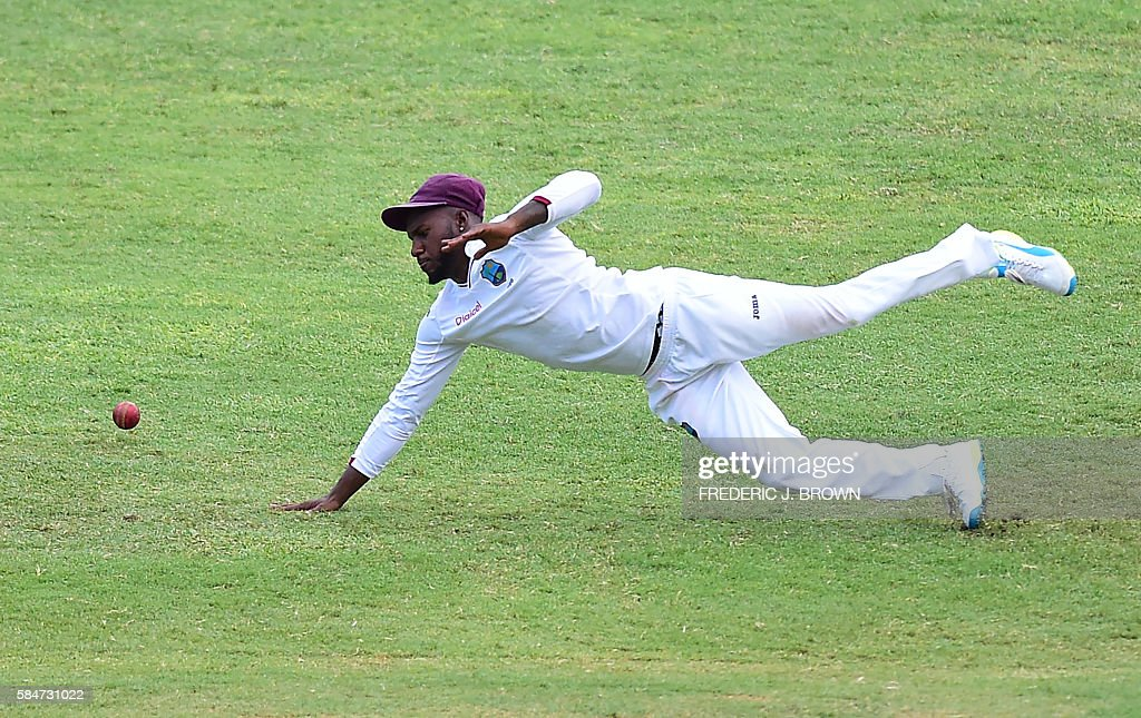 Jermaine Blackwood of the West Indies failed to stop this shot from India's Cheteshwar Purjara off a delivery from bowler Kraigg Braithwaite in the 34th over on July 30, 2016 in Kingston, Jamaica on the first day of the 2nd Test between India and the West Indies. / AFP / Frederic J. BROWN