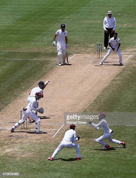 Jermaine Blackwood of West Indies takes a catch off the bowling of Devendra Bishoo to dismiss Jonathan Trott of England during day three of the 2nd...