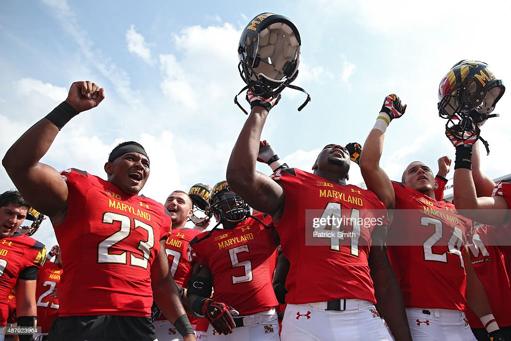 Jermaine Carter Jr. #23 of the Maryland Terrapins and teammates sing with fans after defeating the Richmond Spiders at Byrd Stadium on September 5, 2015 in College Park, Maryland. The Maryland Terrapins won, 50-21.