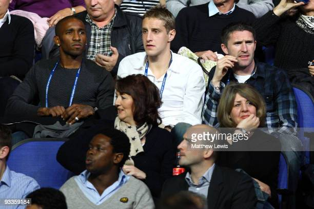Jermaine Defoe Michael Dawson and Robbie Keane of Tottenham Hotspurs watch Andy Murray of Great Britain play in the men's singles second round match...