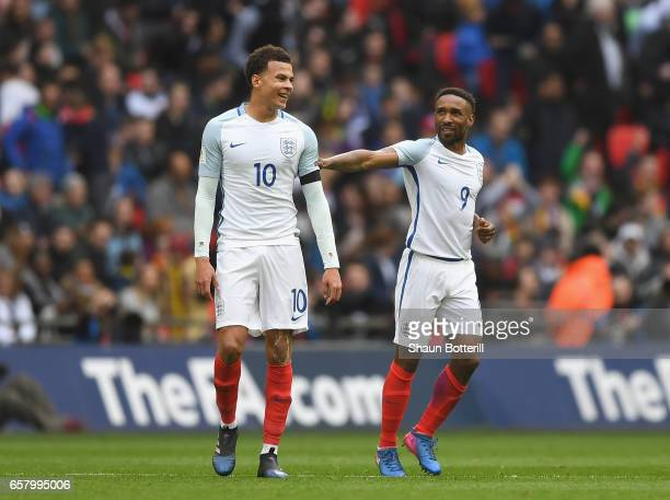 Jermaine Defoe of England and Dele Ali of England share a joke during the FIFA 2018 World Cup Qualifier between England and Lithuania at Wembley...
