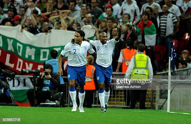 Jermaine Defoe of England celebrates after scoring a goal to make it 10 with Glen Johnson of England