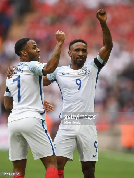 Jermaine Defoe of England celebrates with Raheem Sterling after scoring his sides first goal during the FIFA 2018 World Cup Qualifier between England...