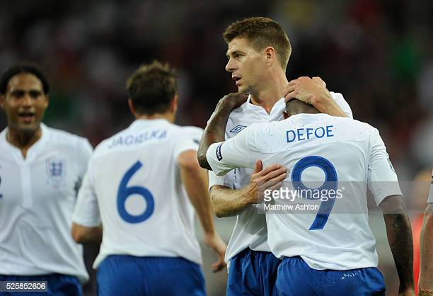 Jermaine Defoe of England gets congratulated by Steven Gerrard after scoring his hat trick to make it 40