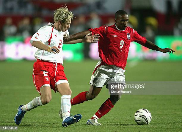 Jermaine Defoe of England holds off Sabastian Mila of Poland during the 2006 World Cup Quailfier Group 6 match between Poland and England at the...