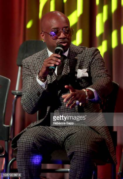 GRAMMY Museum Curator Nwaka Onwusa and GRAMMY Museum Artistic Director Scott Goldman present Jermaine Dupri with award at A Conversation With...