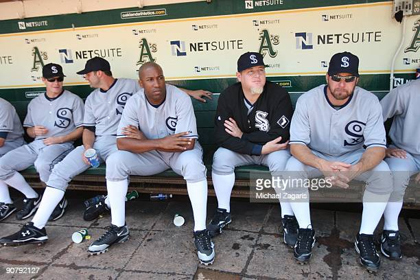 Jermaine Dye Bobby Jenks and Mark Kotsay of the Chicago White Sox in the dugout before the game against the Oakland Athletics during the 1929themed...