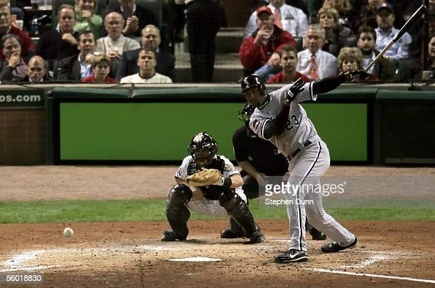Jermaine Dye of the Chicago White Sox hits an RBI single in the eighth inning off Brad Lidge of the Houston Astros during Game Four of the Major...