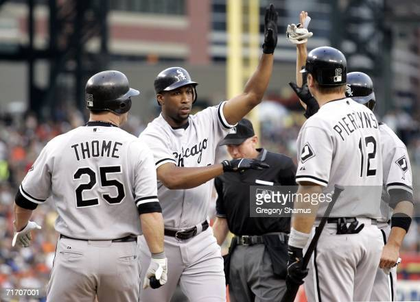 Jermaine Dye of the Chicago White Sox is congratulated by AJ Pierzynski and Jim Thome after a first inning three run home run against the Detroit...