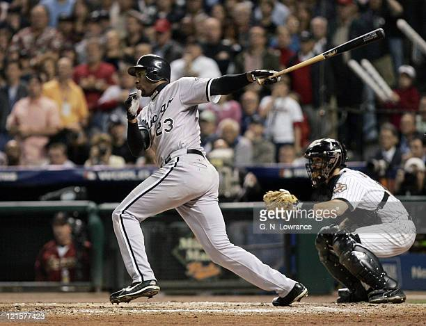 Jermaine Dye of the Chicago White Sox singles to drive in Willie Harris in the 8th inning during game 4 of the World Series against the Houston...