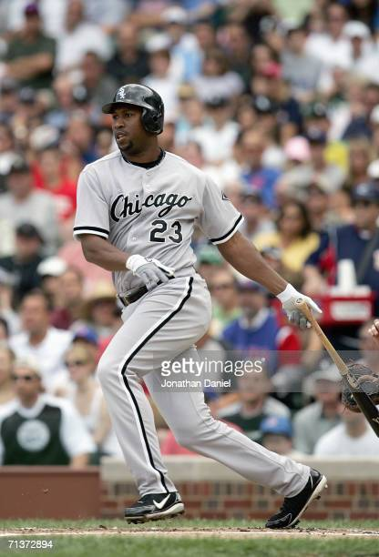 Jermaine Dye of the Chicago White Sox swings at the pitch during the game against the Chicago Cubs on June 30 2006 at Wrigley Field in Chicago...