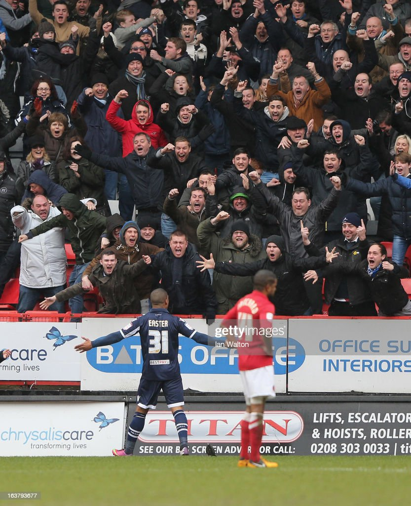 Jermaine Easter of Millwall celebrates scoring the first goal during the npower Championship match between Charlton Athletic and Millwall at The Valley on March 16, 2013 in London, England.