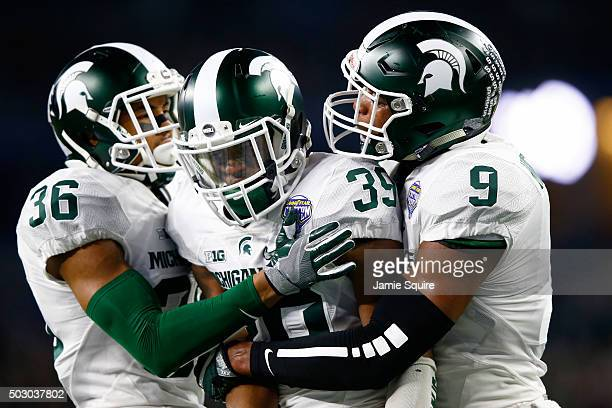 Jermaine Edmondson celebrates with Arjen Colquhoun and Montae Nicholson after breaking up a pass in the second quarter against the Alabama Crimson...