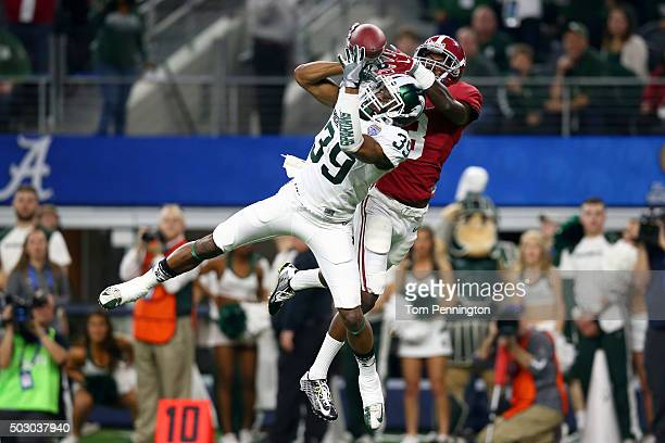 Jermaine Edmondson of the Michigan State Spartans breaks up a pass intended for Calvin Ridley of the Alabama Crimson Tide in the second quarter...