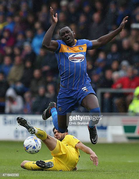 Jermaine Grandison of Shrewsbury Town is fouled by Bobby Reid of Plymouth Argyle during the Sky Bet League Two match between Shrewsbury Town and...