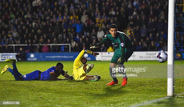 Jermaine Grandison of Shrewsbury Town scores an own goal past goalkeeper Jayson Leutwiler of Shrewsbury Town during the Capital One Cup Fourth Round...