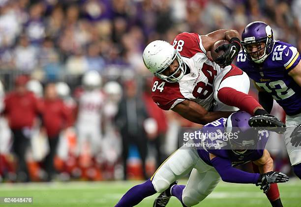 Jermaine Gresham of the Arizona Cardinals breaks a tackle while carrying the ball for a touchdown in the second quarter of the game against the...