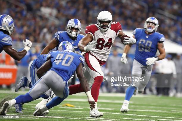 Jermaine Gresham of the Arizona Cardinals tries to break the tackle of Jarrad Davis of the Detroit Lions at Ford Field on September 10 2017 in...