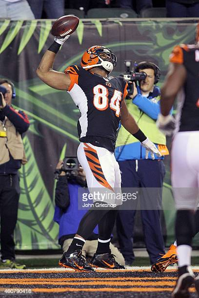Jermaine Gresham of the Cincinnati Bengals celebrates after scoring a touchdown during the second quarter of the game against the Denver Broncos at...